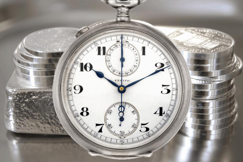 Silber-Edelmetall-als-Barren-und-Münze-mit-Zenith-silbernen-Taschenuhr-Chronograph